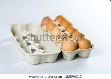 Funny brown egg with smile among others in grey container #182596313