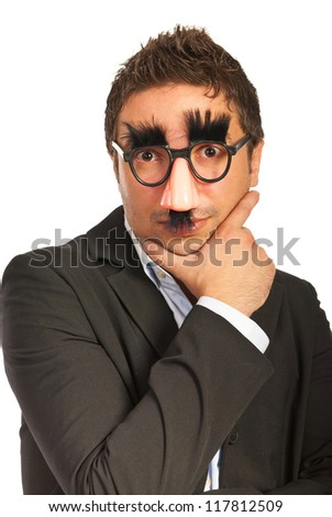Funny business man with mask holding hand to face isolated on white background
