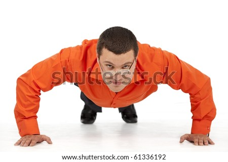 Funny businessman doing push-ups, looking on laptop screen
