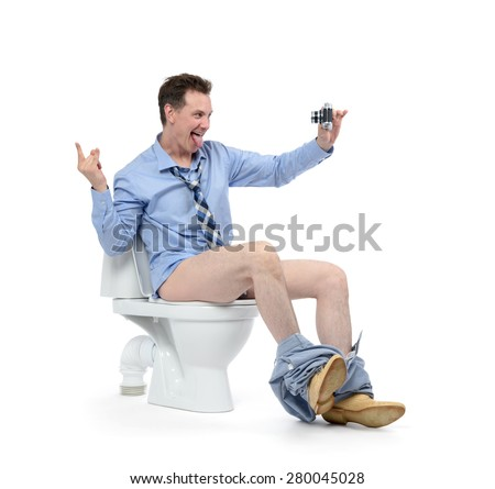 Funny businessman photographing himself in the toilet on white background. Selfie everywhere concept