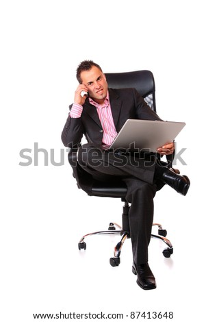 Funny businessman sitting and working on laptop. Isolated on white background