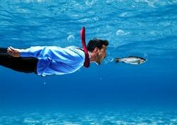 Funny businessman swimming underwater