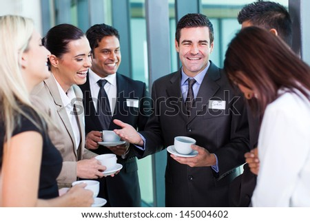 funny businessman telling a joke during conference coffee break