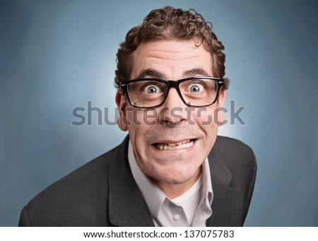 Funny businessman with crazy expression