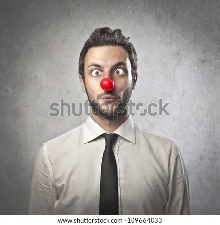 Funny businessman with red plastic nose