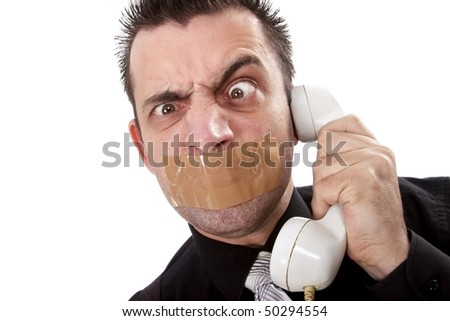 Funny businessman with tape on his mouth listening to someone on phone