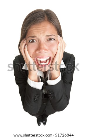 Funny businesswoman with stress isolated. High angle view fish eye like image of stressed young woman in suit, Isolated on white background.
