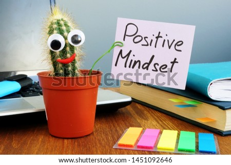 Funny cactus is holding sign Positive mindset.
