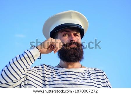 Funny captain sailor wearing hat. Seaman fun. Portrait of serious captain. Bearded sailor, seaman