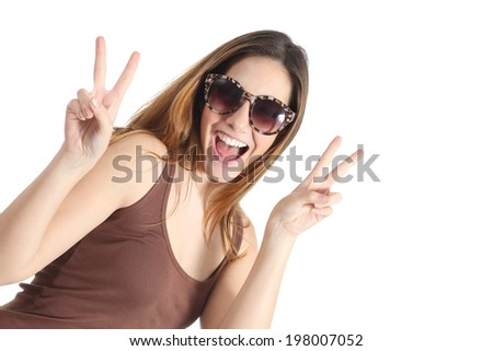 Funny casual teenager girl wearing fashion sunglasses gesturing victory isolated on a white background                   #198007052