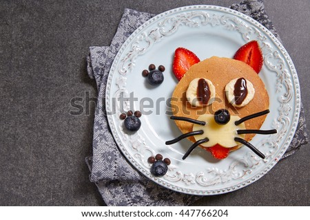Funny cat pancake with berries for kids breakfast #447766204