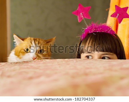 Stock Photo Funny caucasian girl look out from the bed
