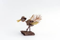 Funny character made by child from pine cone and other nature materials from forest, autumn craft for kids,