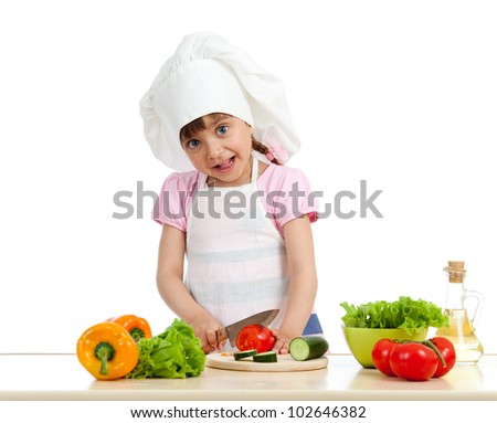 Funny chef girl preparing healthy food over white background