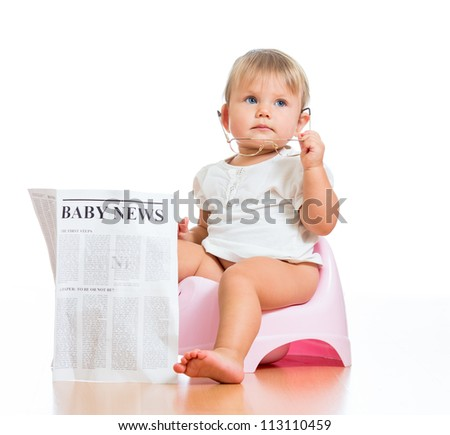 funny child girl sitting on chamberpot with eyeglasses and newspaper