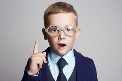 funny child in glasses and suit.genius Kids.idea