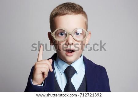 funny child in glasses and suit.genius Kids.idea