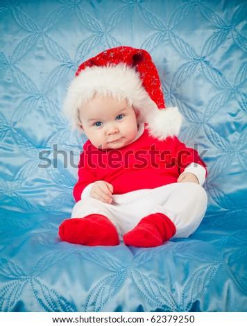 funny child in santa costume