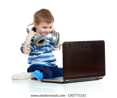 Funny child playing with laptop isolated on white background - stock photo