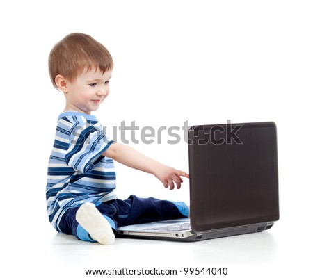 Funny child using a laptop over white background
