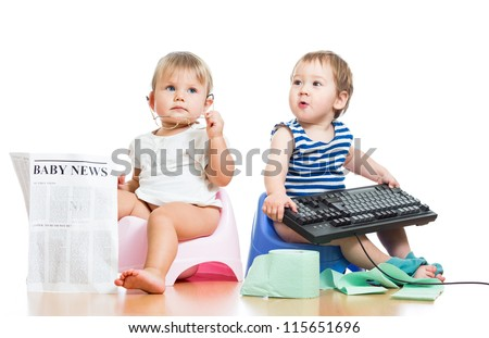 funny children girl and boy sitting on chamberpot with newspaper and keyboard
