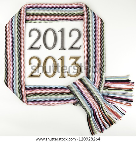Funny Christmas frame made of warm scarf and numbers 2012 - 2013, New Year's theme