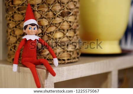 Funny Christmas toy elf on shelf. American christmas traditions. Xmas activities for family with kids. #1225575067