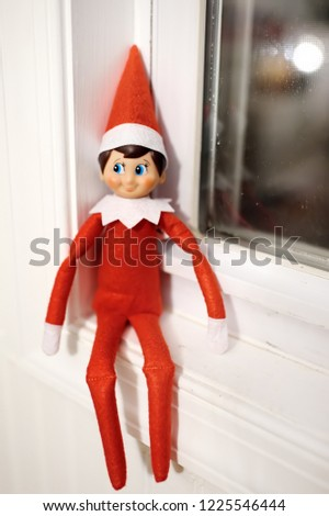 Funny Christmas toy elf on window. American christmas traditions. Xmas activities for family with kids. #1225546444