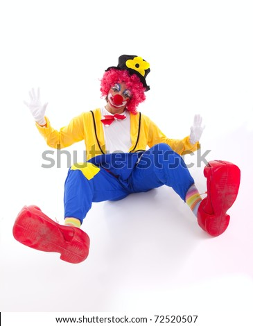 Funny circus clown falling on the floor (isolated on white)