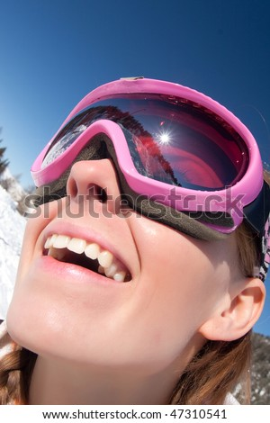Funny close portrait of a young girl in ski mask