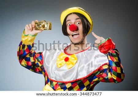 Funny clown against dark background