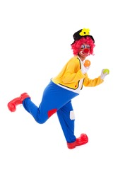 funny clown holding color balls (isolated on white)