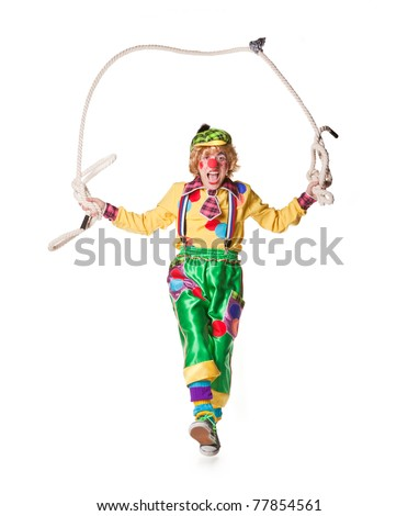 Funny clown jumps on a skipping rope isolated on white background