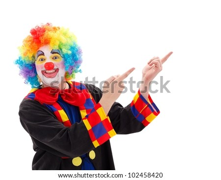 Funny clown pointing happily upward onto copy space - stock photo