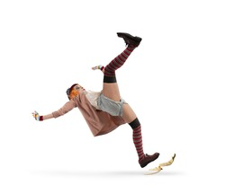 Funny clown slips on a banana peel. concept of unlucky
