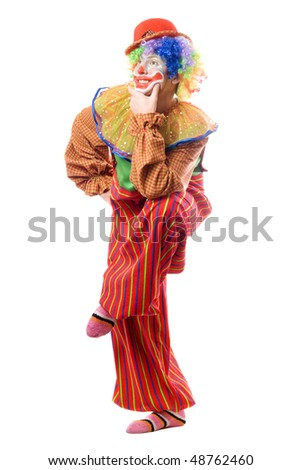 Funny clown standing on one leg. Isolated