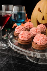 Funny cookie with brains of marzipan on Halloween