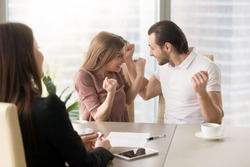 Funny couple excited by purchasing real estate meeting with agent to get the keys, delighted young family enjoys buying first apartment, achieving goal, affordable property, home loan with low rates