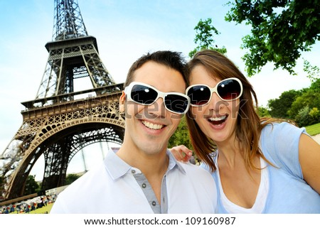 Funny couple in front the Eiffel Tower