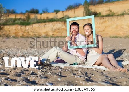 funny couple on the beach