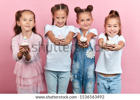 funny crazy children having fun at birthday party, craziness, cose up portrait, isolated pink background, studio shot