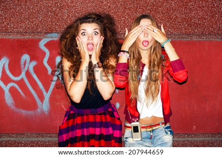Funny crazy emotional pretty girls having fun and surprised ofter night party together on the street background in city