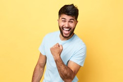 funny crazy football fan rejoicing at victory. man is mad at sport. close up portrait, positive feeling and emotion, luck concept