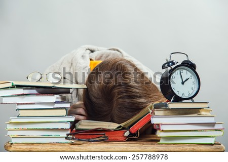 funny crazy  girl student with glasses reading books