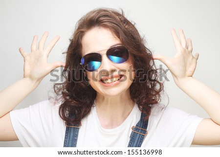 funny curly woman with sunglasses, emotional picture #155136998