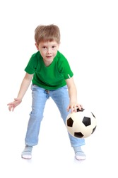 Funny cute little boy in a green t-shirt and jeans throws hands soccer ball-Isolated on white