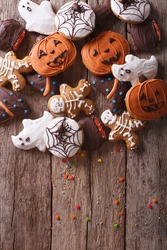 Funny delicious gingerbread for Halloween close-up on the table. vertical top view