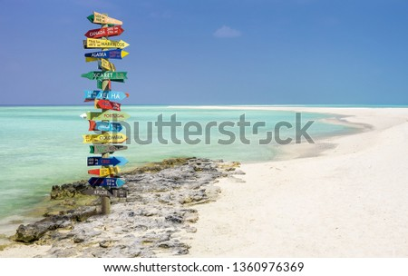 Funny different world directions signpost with distance to many different countries #1360976369