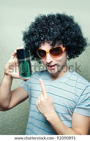 Funny disco guy with perfume bottle