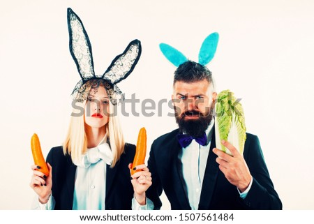 Funny easter couple. Funny easter bunny coupe. Two funny rabits. Funny couple in banny ears